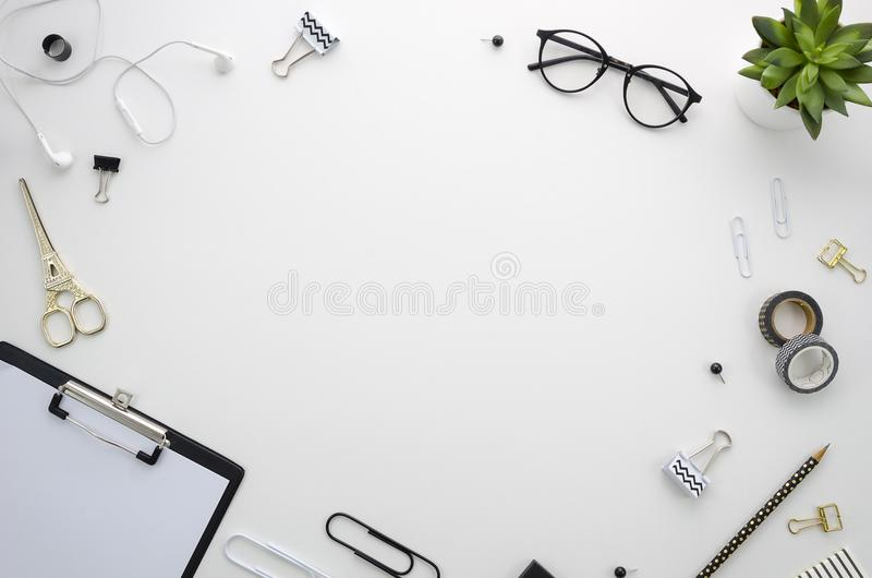 Home office desk workspace with office accessories on white background. Flat lay, top view Home office desk workspace with office accessories including stock image