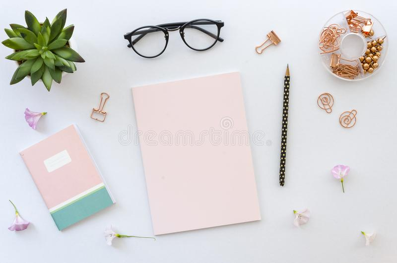 Flat lay, top view office table desk workspace with office accessories including blank paper for lettering, notepad royalty free stock photos