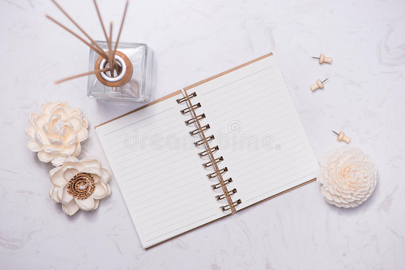 Flat lay, top view of open notebook with aroma bottle glass and royalty free stock photo
