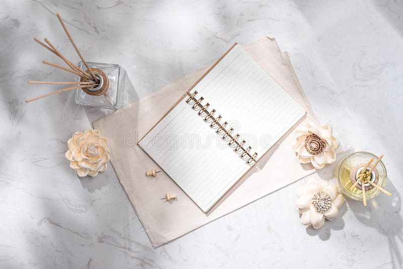 Flat lay, top view of open notebook with aroma bottle glass and stock photo