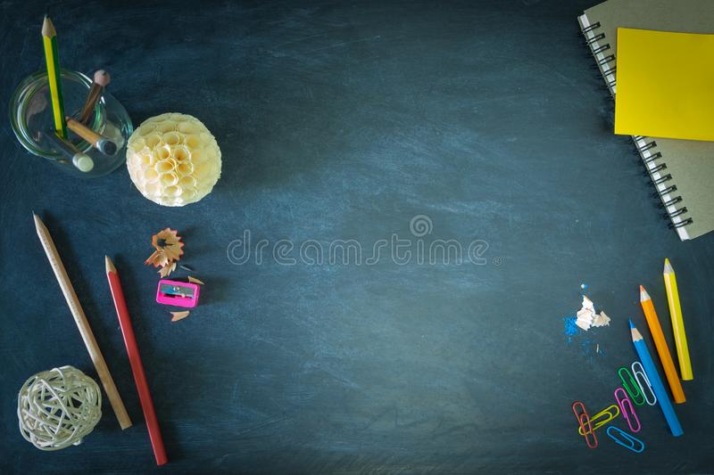 Flat Lay, Top View of School Supplies Border Banner on chalkboard Color, Chalk, Pencil, Sharpener, Notebook, PaperClip, Stationery royalty free stock images