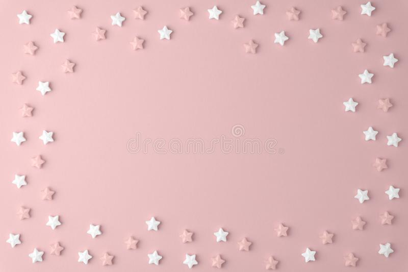 Flat lay top view tasty appetizing concept, minimal Sweet star Candy marshmallow Colorful pattern on pink pastel background royalty free stock photography
