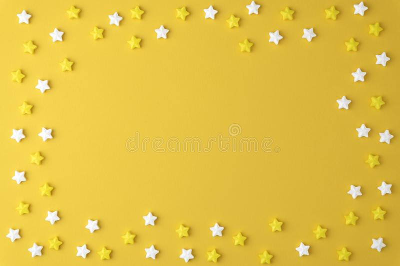Flat lay top view tasty appetizing concept, minimal Sweet star Candy marshmallow Colorful pattern on yellow pastel background. And copy space for your design royalty free stock images