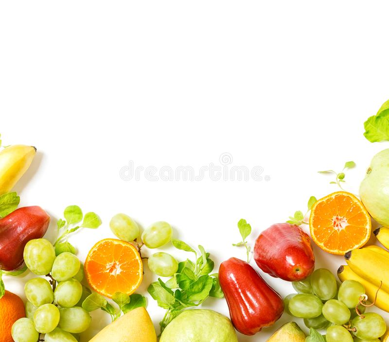 Flat lay top view tropical fruits frame background: grape, rose apple, orange, spinach, mango, pear, guava and banana. Healthy dri royalty free stock photo