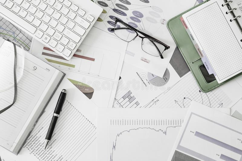 Flat lay top view of works place office desk with eye glasses, diary, organizer, pen, business documents, paperwork and wireless royalty free stock photos