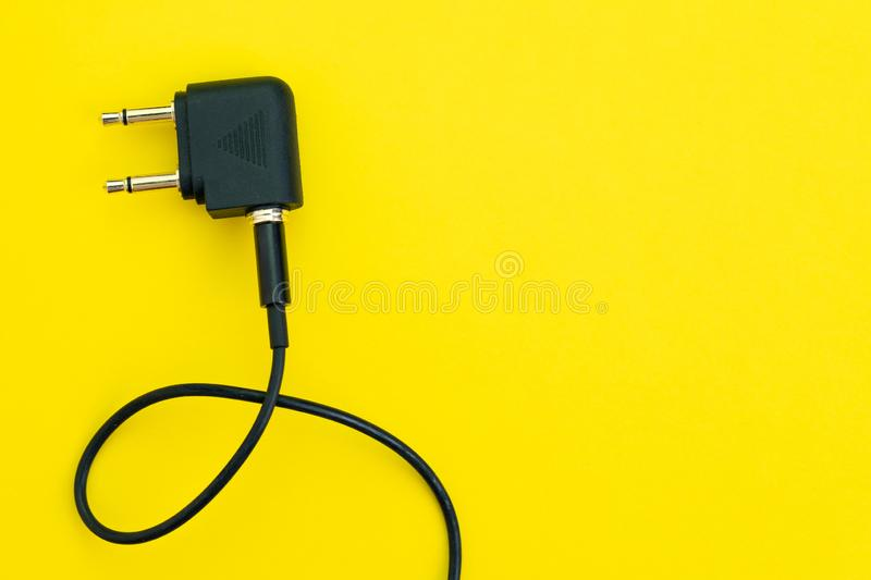 Flat lay of topview of headphone audio jack with 2 legs and black cable using in airplane, preparing for travel and tourist royalty free stock photo
