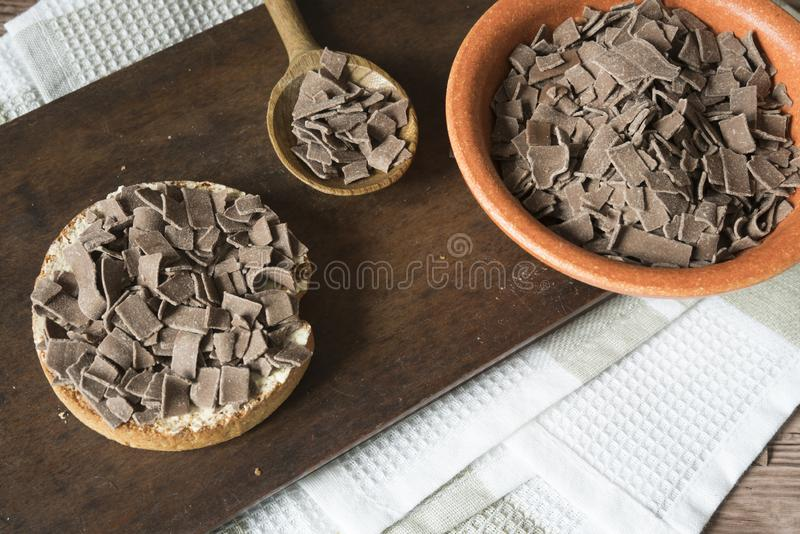 Dutch breakfast with rusk and chocolate hail, flakes, on cutting board stock photos