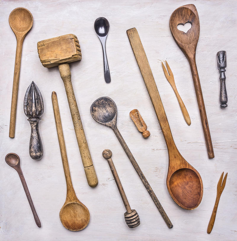 Flat lay variety of wooden cutlery, spoons, forks, meat beater wooden rustic background top view close up stock photo