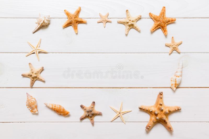 Flat lay of various seashell and starfish on white wooden table, top view. Copy space background, summer concept stock photos
