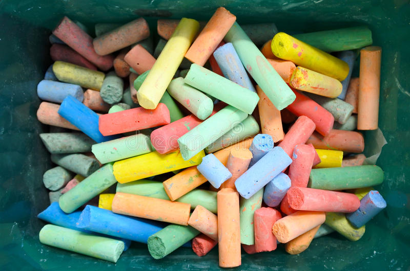 Flat lay view of Coloured chalks in a box royalty free stock image