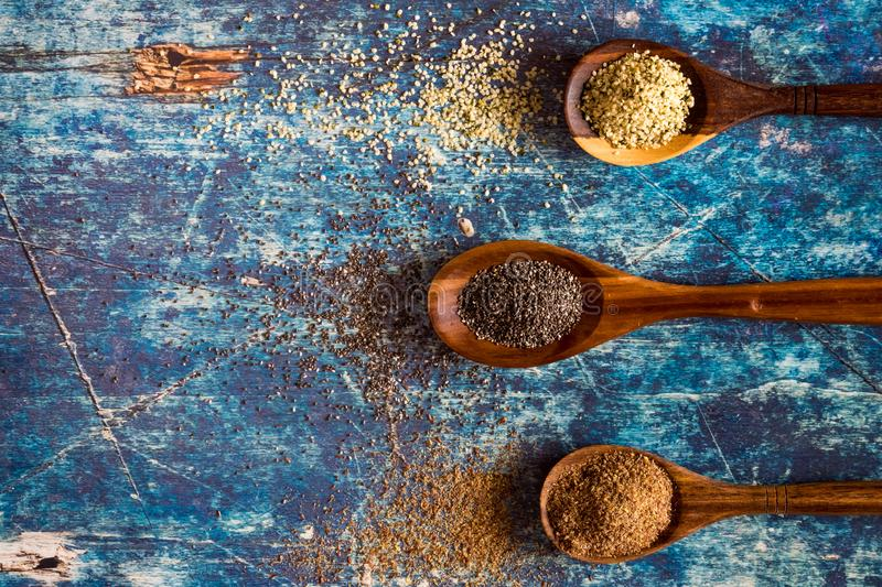 Healthy seeds on wooden spoons royalty free stock photography