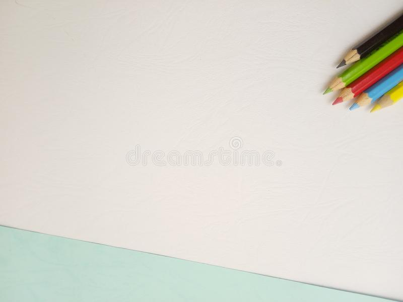Flat Lay, White Photo Blank Template for Background Element Design for message, quote, information text placement with Blue Pencil. White Photo Blank Template royalty free stock photo