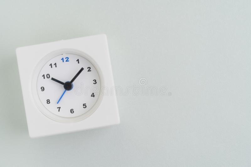 Flat lay of white rectangular alarm clock on texture white background with copy space using as time, deadline or schedule stock photos