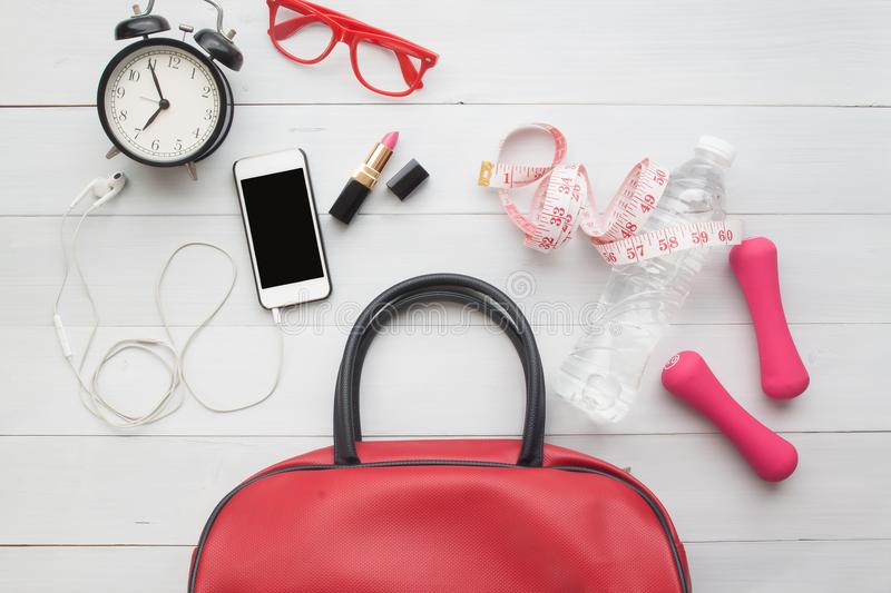 Flat lay of woman essentials and sport equipments on white wooden background, Lifestyle beauty and healthy concept royalty free stock image