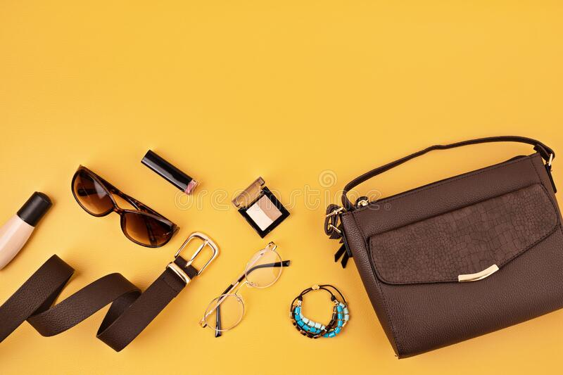 Flat lay with woman fashion accessories over yellow background. Fashion, online beauty blog, summer style, shopping and trends. Concept. Top view royalty free stock image