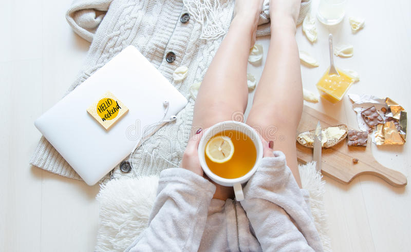 Flat lay woman in pajamas with cup of herbal tea. Romantic morning breakfast. Flat lay shot of Soft photo of woman in pajamas with cup of herbal tea, top view royalty free stock images