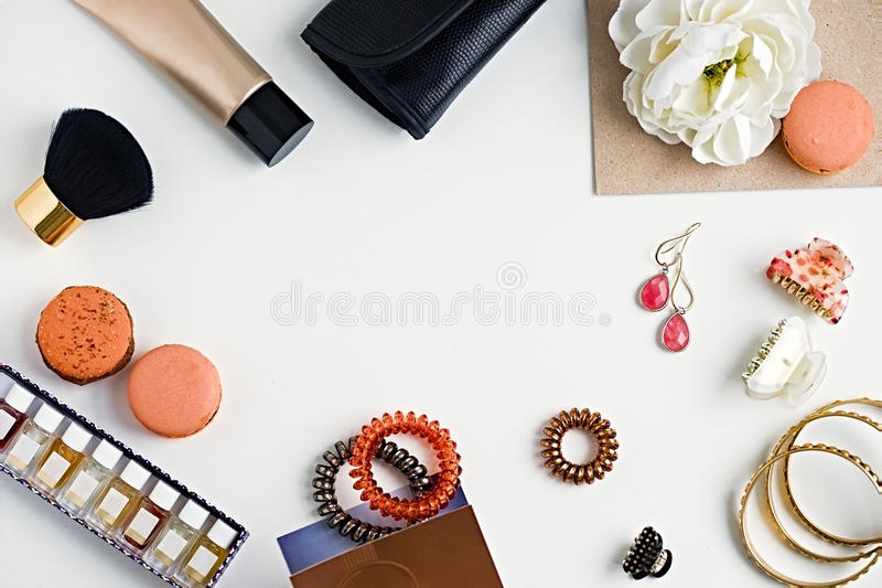 Flat lay of woman`s fashion beauty products on a white backgroun stock image