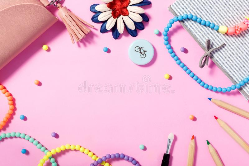 Flat lay of woman`s lifestyle, accessories and cosmetics with pink background. Flat lay of woman`s lifestyle, accessories and cosmetics with paper pink royalty free stock photo