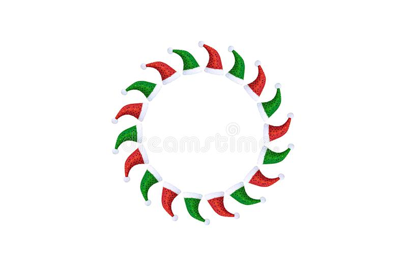 Flat layout of Christmas caps in green and red in the form of a circle on a white background. stock image