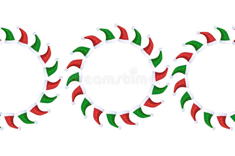 Flat layout of Christmas caps in green and red in the form of circles on a white background. stock photography