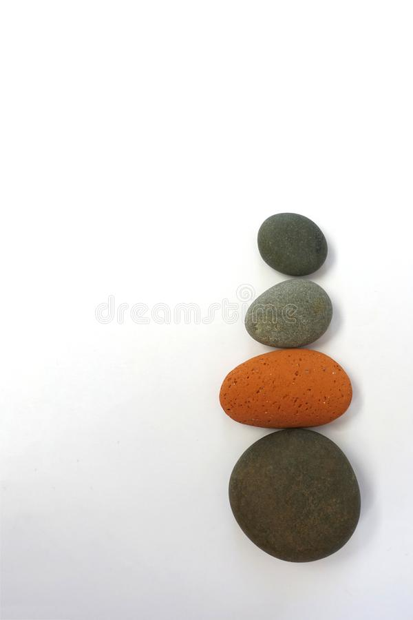 Multicolored Stones against White Background royalty free stock image