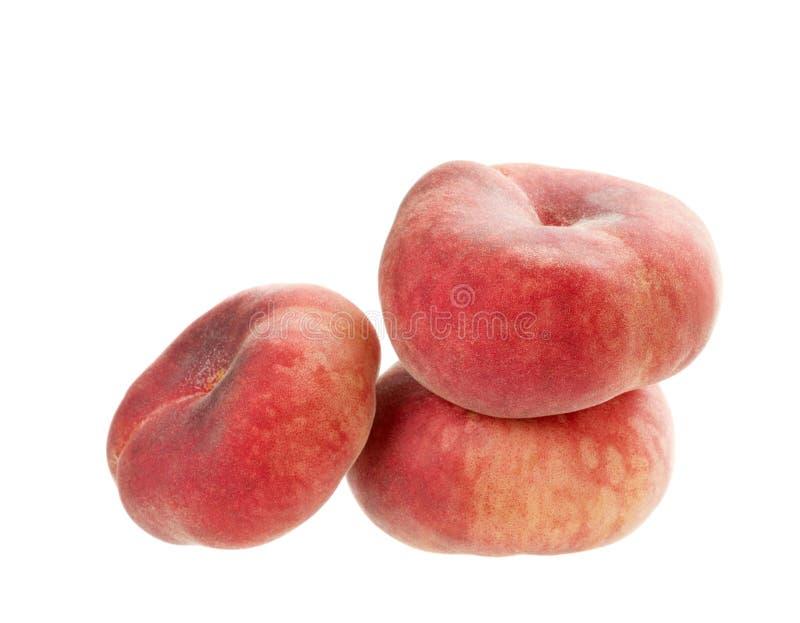 Flat peaches isolated stock photo