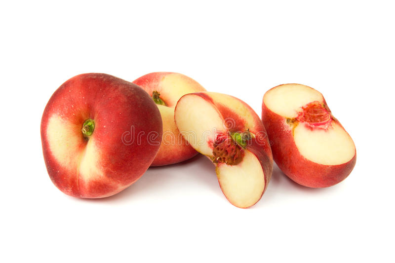Flat peaches with sections stock photo