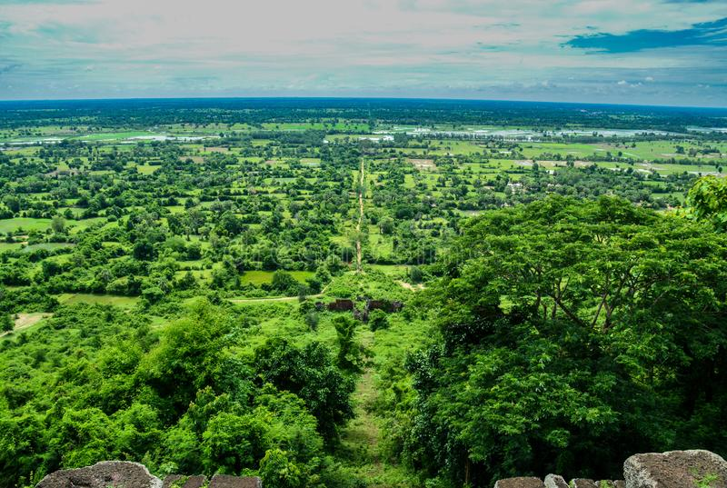 Flat plains of Kampot. The vast green fields of Kampot as seen from the top of Bokor Mountain stock photography