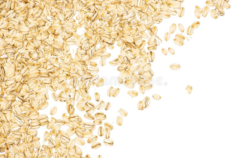 Flat raw rolled oats isolated on white stock image