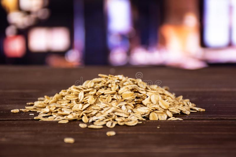 Flat raw rolled oats with restaurant stock image