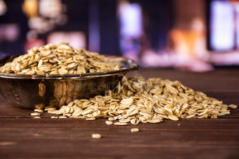 Flat raw rolled oats with restaurant royalty free stock image