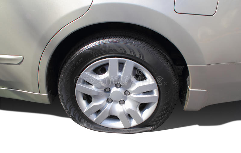 Flat Rear Car Tire. Shiny, rear, flat car tire isolated on white stock images
