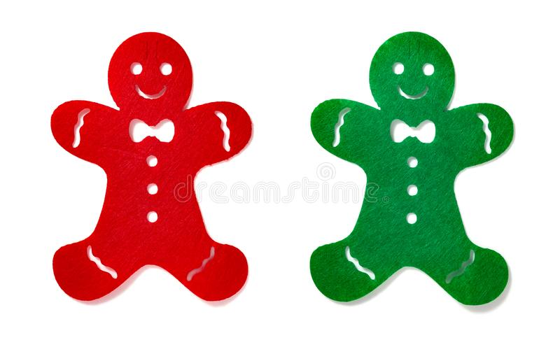 Flat red and green gingerbread men on white background royalty free stock photography