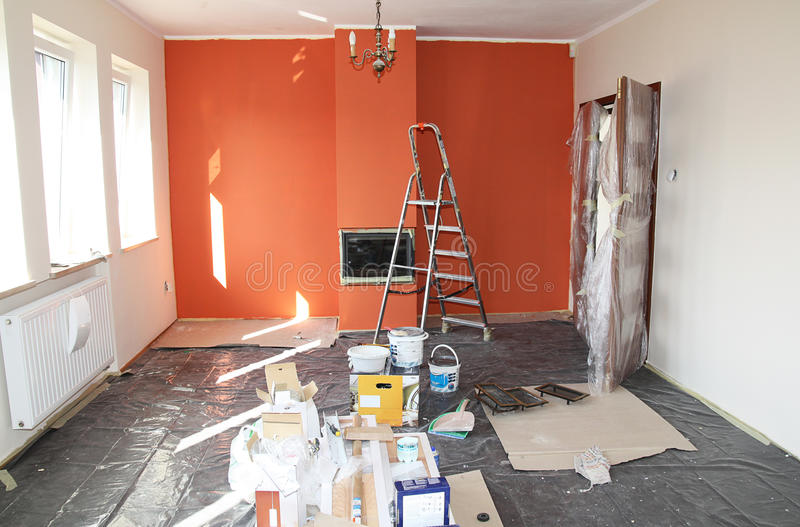 Flat renovation. Painting the wall and fireplace stock photography
