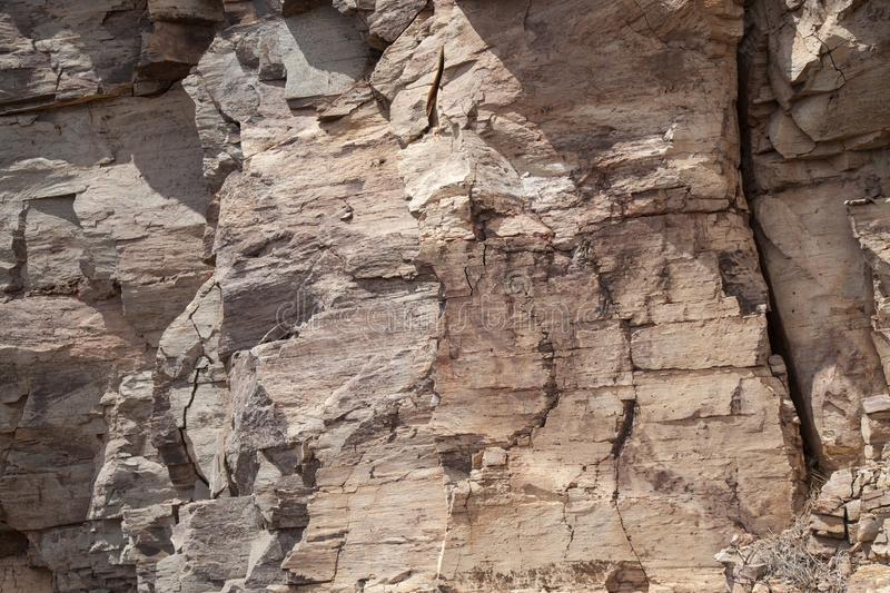 Flat rock surface. With many cracks natural background stock images