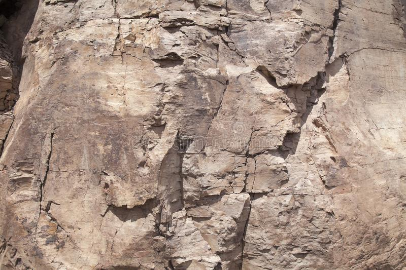 Flat rock surface. With many cracks natural background royalty free stock images