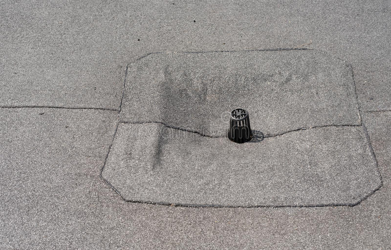 Flat roof drain close up. Roll waterproofing royalty free stock photos