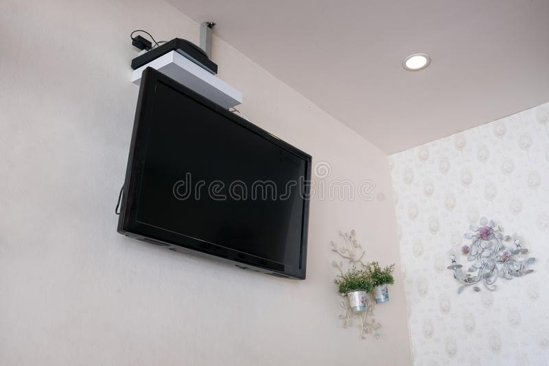 Flat screen tv lcd on wall with decor flower. Flat screen tv lcd on wall with decor vintage flower royalty free stock images