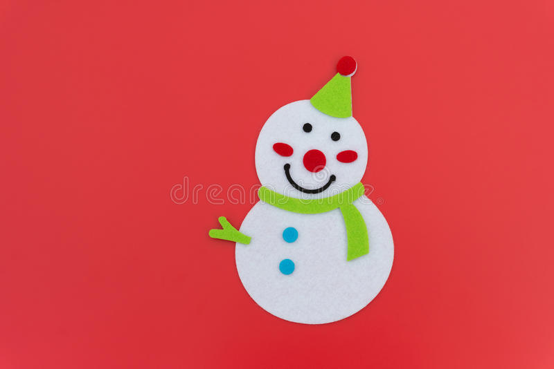 Flat smiling toy christmas snowman with green scarf stock image