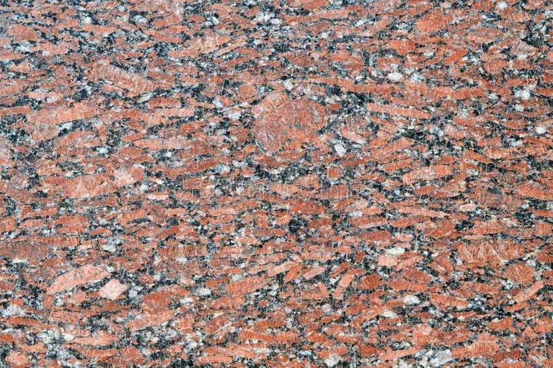 The flat surface of a natural marble or brown granite slab. royalty free stock photos