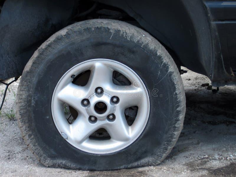 Flat tire. Close up shot of a flat tire stock photo