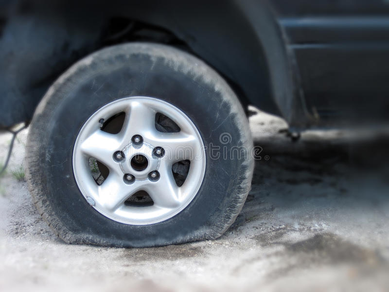 Flat tire. Close up shot of a flat tire stock photography