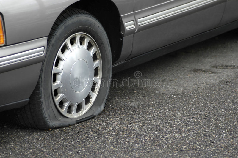Flat Tire. Car on the road with a flat tire not moving stock photo