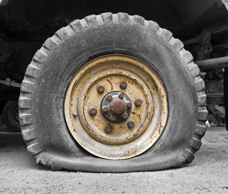 Flat tire. Of a truk royalty free stock image