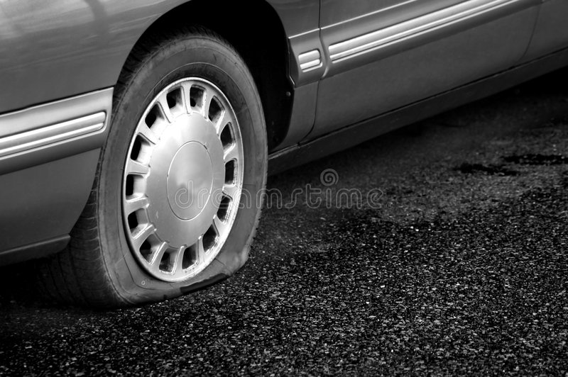 Flat Tire. Detail Shot of a Flat Tire on a Car stock photos