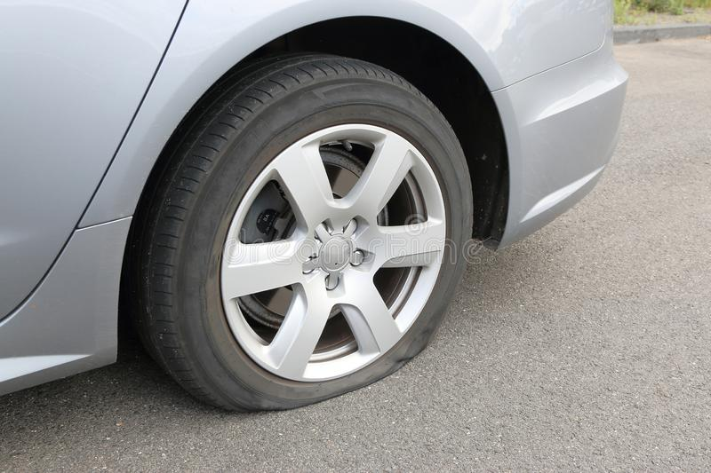 Flat tire on a car. Mishap on the road stock photography