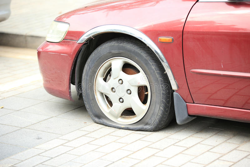 Flat tire on car wheel. Closeup of flat tire on car wheel royalty free stock image