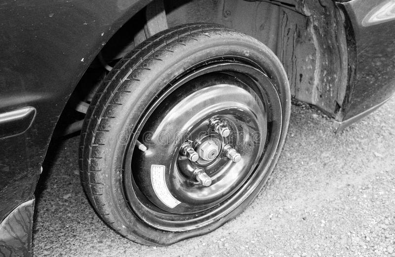 Flat Tire. On spare wheel in vehicle on a road royalty free stock images