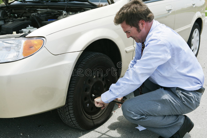 Download Flat Tire - Lossen Lugs stock image. Image of change, blacktop - 2762423