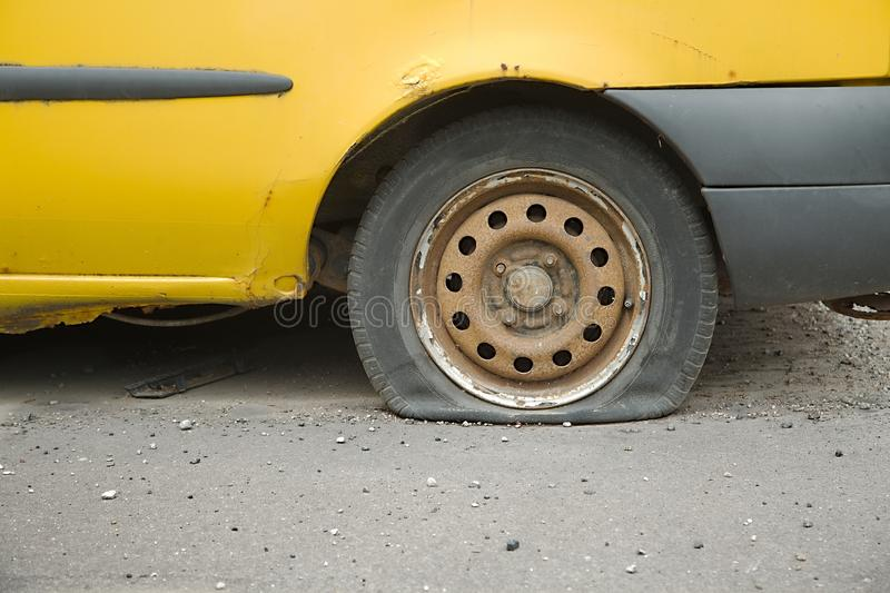 Flat Tire. Of an old car stock images